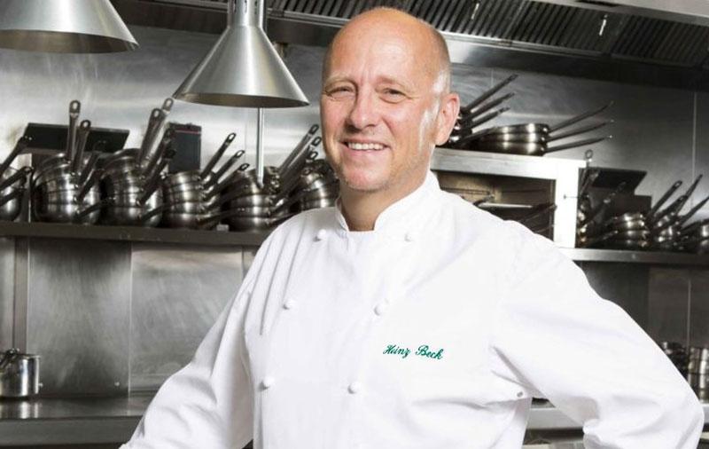 Heinz Bek (5 Michelin stars) poses in the restaurant kitchen
