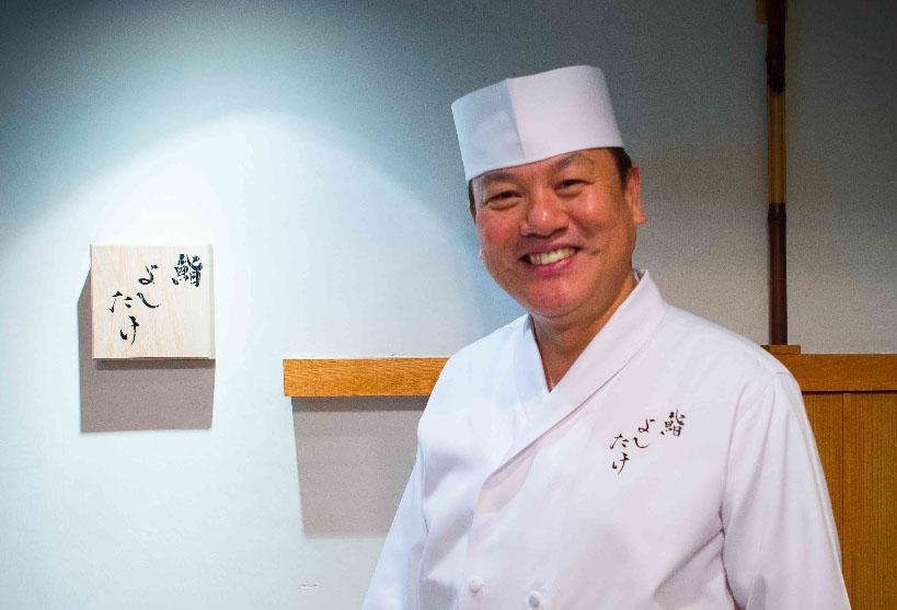 Masahiro Yoshitake (6 Michelin stars) smiling and posing